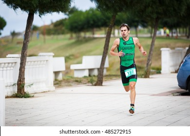 CASTRO URDIALES, SPAIN - SEPTEMBER 17: Unidentified triathlete in the running competition celebrated in the triathlon of Castro Urdiales in September 17, 2016 in Castro Urdiales, Spain