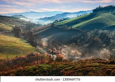 Castrocaro Terme e Terra del Sole, Forli-Cesena, Emilia Romagna, Italy: landscape at sunrise of the picturesque hills with fog in the valley