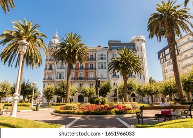 CASTRO-URDIALES, SPAIN - Aug 17, 2019: Wide angle view of the Plaza de los Jardines (Garden Square), a park, and one of its buildings
