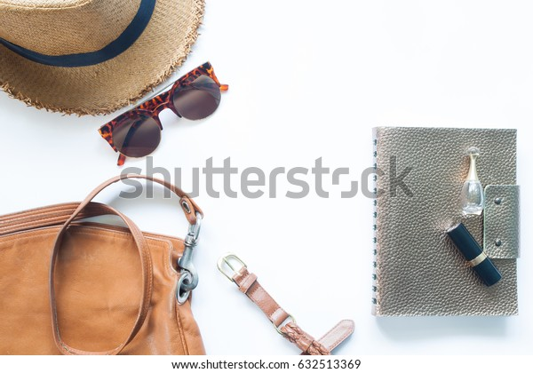 Casual accessories in brown color and leather on white background