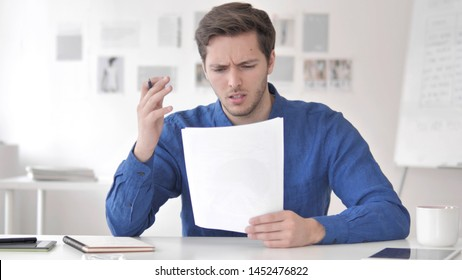 Casual Adult Man Reacting to Failure of Contract