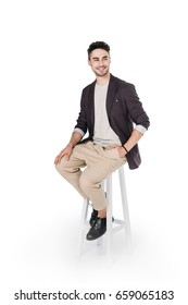 casual african caucasian man posing while sitting on chair isolated on white
