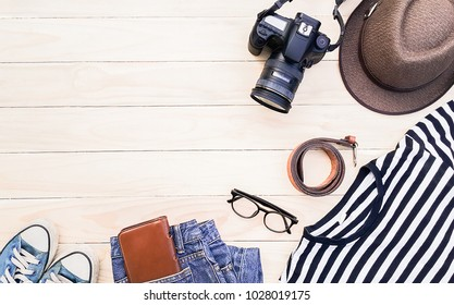 Casual apparel and accessories on a background of wood.Topview