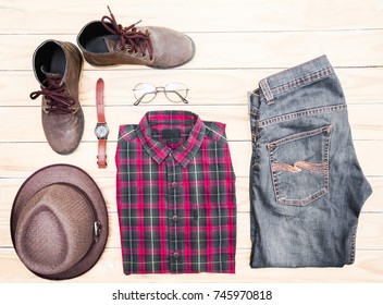 Casual apparel and accessories on a background of wood.Top view