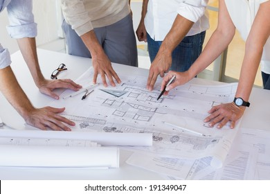 Casual architecture team working together at desk in the office