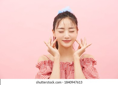 Casual beauty concept of pretty Asian girl on pink background
