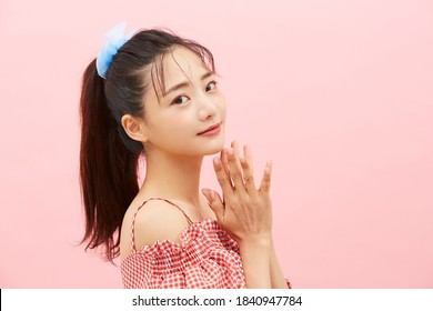 Casual beauty concept of pretty Asian girl on pink background - Shutterstock ID 1840947784