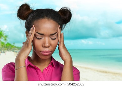 casual black woman with headache