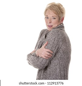 casual blond woman in her fifties is cold on white background