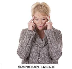 casual blond woman in her fifties having a headache