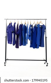 casual blue clothes on hanger in Clothing store