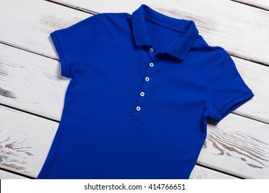 a56f9df11dff Casual blue polo t-shirt. T-shirt on white wooden background. Basic