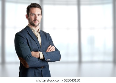 Casual business man with arms crossed