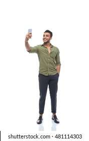 Casual business man happy smile taking selfie photo on cell smart phone young handsome guy full length wear shirt isolated white background