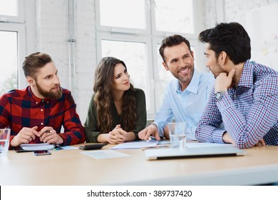 Casual business partners talking during business meeting in office.