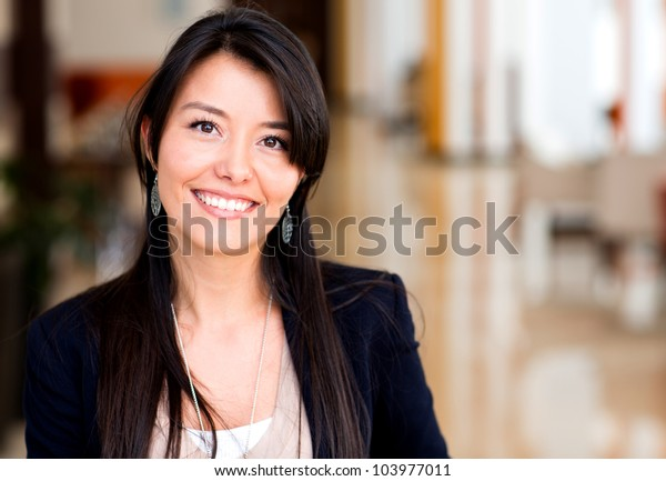 Casual business woman looking happy and smiling
