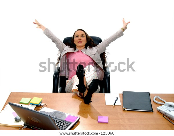 Casual business woman stretching with feet up on desk