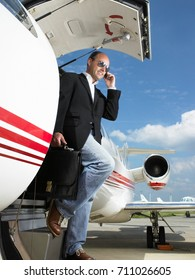 Casual businessman exiting private plane