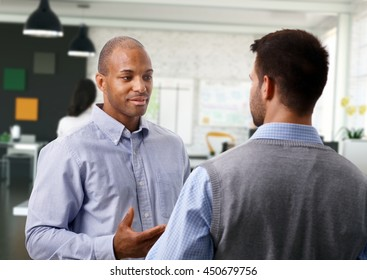 Casual businessmen having discussion at office.