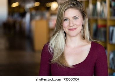 Casual confident portrait headshot from blonde caucasian female student, possible staff member