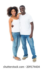 Casual couple in jeans and white tops smiling at camera on white background