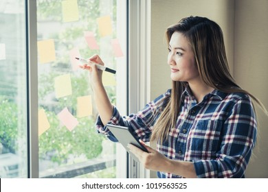 Casual creative business man is writing ideal and goal on to the windows