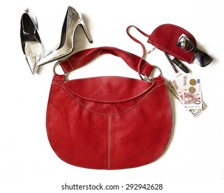 Casual day look.Outfit of young business woman. Essentials for modern young lady. Different female accessories on white background: red bag,phone,money,sunglasses, silver hight heeled shoes, clutch
