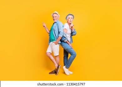 Casual denim shorts shoes clothes outfit style stylish dreamy person concept. Side turned profile full length size photo portrait of handsome granddad sweet cute grandma standing isolated background