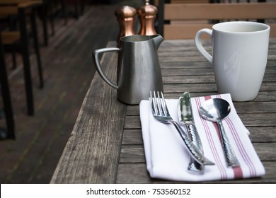 Genial Casual Dining Place Setting, Utensils On A Cloth Napkin Outdoor Table