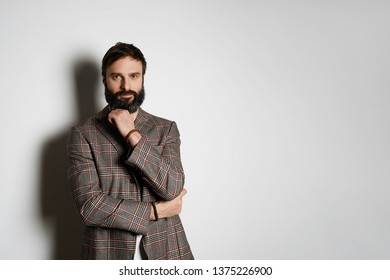 Casual dreesed handsome cheerful man standing over white background and looking camera. Mockup Copy Paste Advertisement