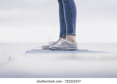 casual dress of the girls -shoes and slim jeans