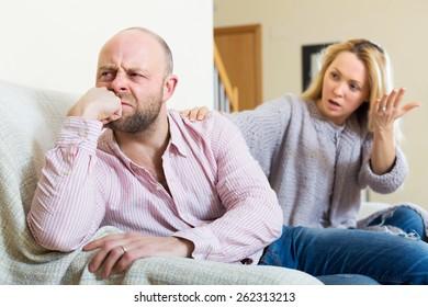 Casual family having quarrel in livingroom