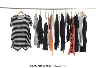 casual fashion female clothing hanging on hangers