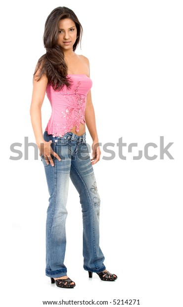 casual fashion girl standing in jeans and a pink top over a white background