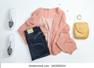 Casual fashion lookbook concept. Clothing and accessory items on white paper textured background with a lot of copy space for text. Top view, flat lay, close up.