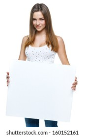 Casual female holding a blank billboard isolated on white background