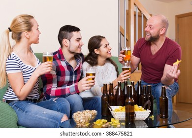 Casual friends having fun at house party together