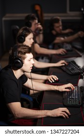 Casual gamers and hardcore fans are gather together in pc gaming club to compete in playing MMO Games online Tournament