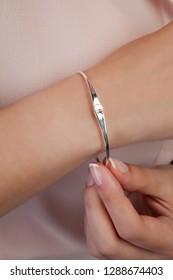 Casual girl with gem bracelet