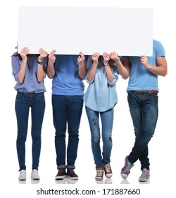 casual group of people hiding their faces behind a blank banner on white background