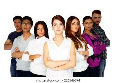 casual group of young serious people looking at the camera on white background
