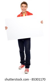 Casual guy with blank placard