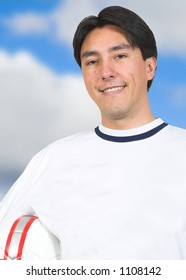 casual guy with a soccer ball with sky on the background