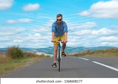 Casual hipster cyclist riding bicycle with high speed concept