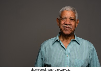 Casual Indian businessman lifestyle shot in a green shirt
