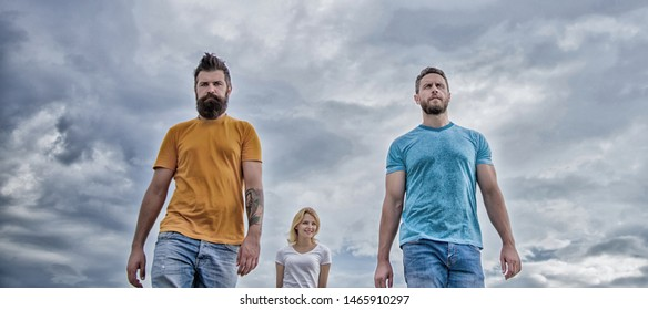 Casual inspired. Fashion people look casual in summer outfit. Pretty woman and men friends walking outdoor. Group of people in casual wear. Young people in casual style on cloudy sky.