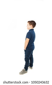 Casual little boy looking on copy space. Isolated on white background
