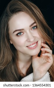 Casual Make-up Model Professional Portrait Shot. Young Woman with Natural Makeup in Studio. Glamour Girl Posing with Fingers on Face. Lady with Blue Eyes and Brown Eyebrows Looking at Camera Shoot