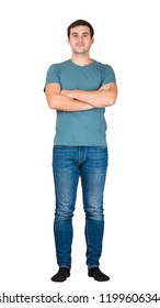 Casual man arms crossed. Full length portrait of a confident boy isolated over white background.