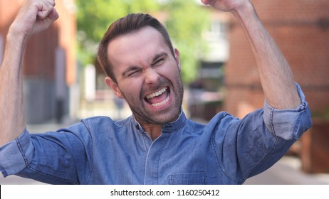 Casual Man Celebrating Success  Gesture in Offcie
